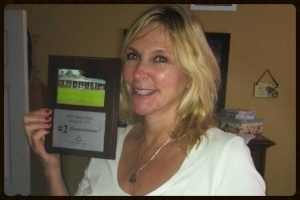 Client with investor plaque
